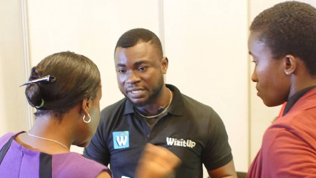 Lawal Abiola (Sales), explaining the WizitUp Educational Package to a client